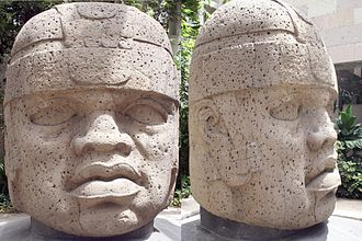 Museo de Antropología de Xalapa - Two views of a giant Olmecs head in the museum discovered at an archaeological site in Texistepec, Veracruz