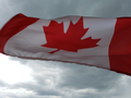 Canada Flag with clouds.png