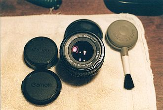 Canon FD lens mount - Canon FD f/1.8, 50mm, with caps.