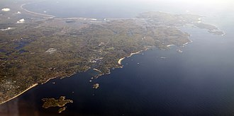 Cape Ann - May 2008 aerial view of Cape Ann in Massachusetts. Gloucester and its harbor are visible to the right.