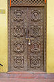 Carved door with 8 auspicious signs, Nepal.jpg