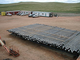 Casing (borehole) - Casing arranged on a rack at a drilling rig in preparation for installation