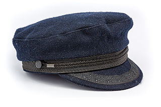 cap with a soft dark blue or white crown and a stiff dark visor, often decorated with braid