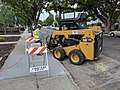 Caterpillar 226D breaking up curb in Campbell, rear view.jpg