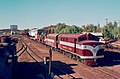 Central Australia Railway -- narrow-gauge freight train in Alice Springs Yard ready to depart south, probably May 1974 (Hugh S Williams).jpg