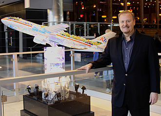 Charles Fazzino - Charles Fazzino with 3-D popart plane sculpture at JFK airport