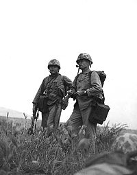 Chesty Puller studies the terrain during the Korean War