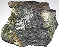 Chromitite band in chromitic serpentinite (early Neoarchean; North Star Mine, near eroded edge of Hellroaring Plateau, Red Lodge Chromite District, Beartooth Mountains, southern Montana, USA) (15188887016).jpg
