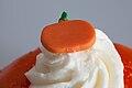 Closeup of pumpkin decoration on Halloween doughnut (15272968559).jpg