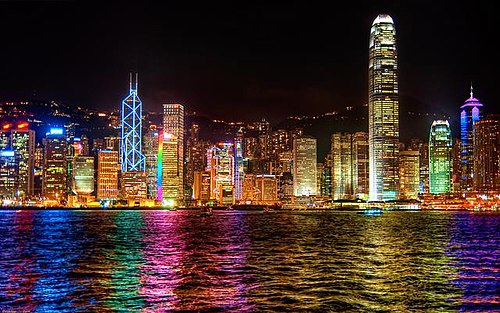 Hong Kong illuminated by colorful artificial lighting. Colorful artificial lighting at night.jpg