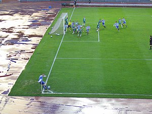 Corner kick - A picture of the exact moment the blue-white team's corner kick is taken.