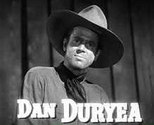 O actor estatounitense Dan Duryea, en una scena d'a cinta Along Came Jones (1945).