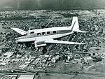 De Havilland Drover DHA over Campbelltown, c. 1946 (20317469250).jpg