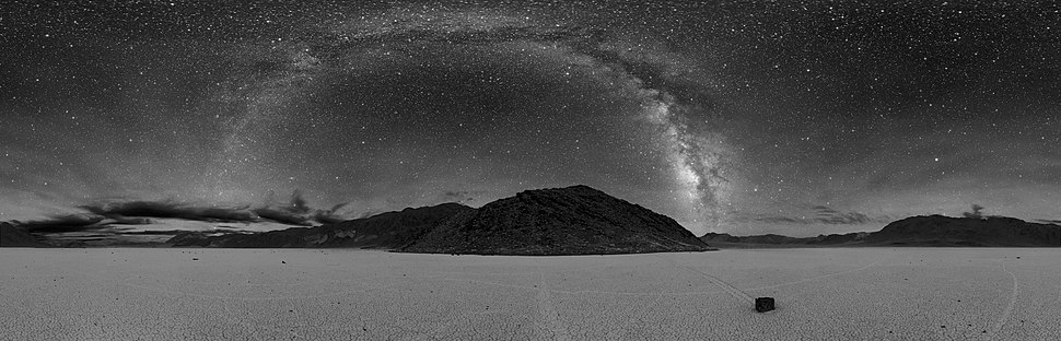 The Milky Way can be seen as a very large streak or arc across the night sky if the visibility conditions are good enough. This panoramic photo was taken at Death Valley.