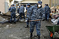 Defense.gov News Photo 110317-N-MU720-019 - U.S. Navy Petty Officer 2nd Class Robert Bannister removes mud sediment from behind a damaged building in Hachinohe Japan on March 17 2011.jpg