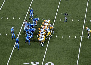 2007 Detroit Lions season - Image: Detroit Lionsvs Green Bay Packers 2007 Favre Kneel