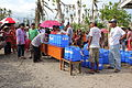 Distributing jerrycans in Santo Nino, Leyte, Philippines (11252770806).jpg