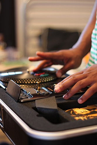"DJ Hero - The ""Renegade"" edition of DJ Hero being played with the controller converted into a table."