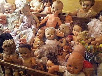 Doll Asylum - Crib filled with dolls, 2015