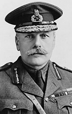 A man with a moustache wearing an army uniform and decorated cap