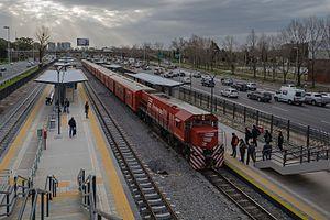 Belgrano Norte Line - A train leaving at Ciudad Universitaria railway station.