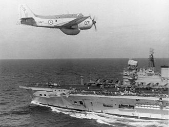 HMS Eagle (R05) - A Fairey Gannet AEW of 849 Naval Air Squadron Fleet Air Arm overflying HMS Eagle in the early 1970s