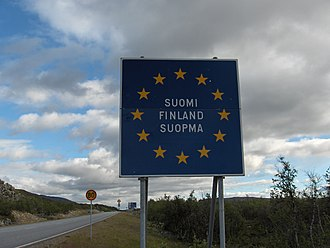 European route E8 - Finnish border sign on the E 8 road at Kilpisjärvi (in Finnish, Swedish and Northern Sami)