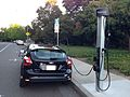 Ford Focus being charged on a roadside ChargePoint station. Rear..JPG