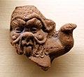 Frammento di statuetta di bes in terracotta, I-III secolo ca.jpg