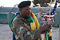 From left, South African Army Pvt. C.R.J. Alexander lowers the South African flag as U.S. Army Pfcs 130721-A-FP002-013.jpg