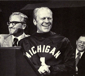 1976 Michigan Wolverines football team - President Ford receives a football jersey during visit to campus in September 1976