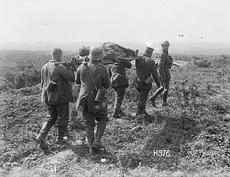 Second Battle of Bapaume - German prisoners carrying a wounded New Zealand soldier on a stretcher, Puisieux, 27 August 1918