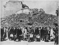Germany. (A line of people with baggage in front of a pile of building rubble.) - NARA - 541694.tif