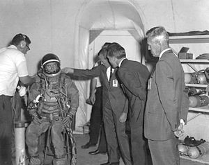 Gordon Cooper adjusts von Braun's suit at Neutral Buoyancy Simulator.jpg