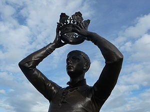 Henriad - Prince Hal tries on the crown, statue by Ronald Gower