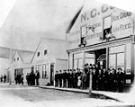 Group of people outside Northern Commercial Company store and a post office, Fairbanks, nd (NOWELL 281).jpeg