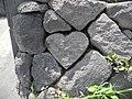 Heart-shaped stone at Yunohira Observatory, Sakurajima.jpg