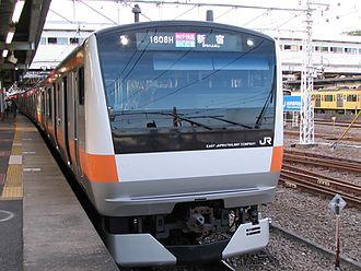 Ōme Line - A Shinjuku-bound Holiday Rapid Okutama (E233 series EMU) at Haijima Station