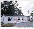 House in street, St Bernard Parish, eight months post Katrina.jpg
