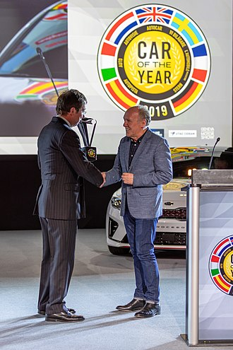 Ian Callum - Callum receives the Car of the Year trophy for the Jaguar I-Pace