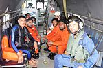 Indian Navy rescuers and the rescued crew members of MV Coastal Pride in an Indian Navy Seaking helicopter.jpg
