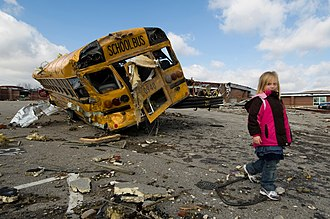Henryville, Indiana - A young girl walks the parking lot of her elementary school in Henryville after the March 2012 tornado.