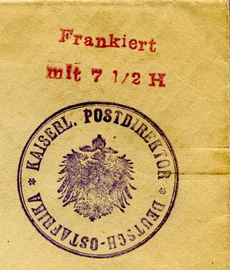 "Indicia (philately) - A handstamp indicium from German East Africa indicating prepayment of postage. A scarcity of postage stamps in WWI caused postal authorities to handstamp ""Frankiert mit 7½ H"" (plus a seal from the director of posts) on envelopes brought in by the public."