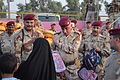 Iraqi army Maj. Gen. Ali Jassim Mohammed Hassen al-Frejee, center, commander of the 17th Iraqi Army Division (IAD), hands out school supplies at a humanitarian aid distribution at Joint Security Station Deason 110804-A-WD436-125.jpg