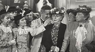 Sarah Edwards (actress) - Sarah Edwards (with black blazer and eyeglasses) in It's a Joke, Son! (1947)