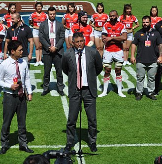 Jamie Joseph giving a speech at a Sunwolves match on 12 May 2018 James Whitinui Joseph-1.jpg