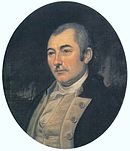 Portrait of somber looking man in a blue uniform with buff waistcoat