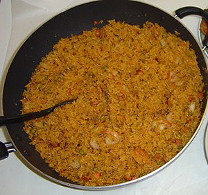Jollof rice, also called 'Benachin' meaning on...