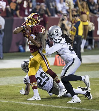 Reggie Nelson - Josh Doctson scoring his first career touchdown against the Oakland Raiders with cornerback David Amerson and safety Reggie Nelson covering him.