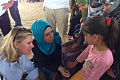 Justine Greening talking with Syrian children at a UK-funded clinic in the Zaatari refugee camp, Jordan (9712014008).jpg